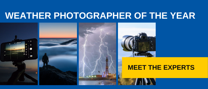 A picture containing a smartphone camera, lightning over Blackpool Tower, clouds over mountains and a digital camera on a tripod