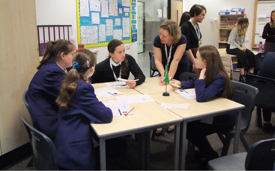 Sylvia Knight with students at Greenfaulds High School